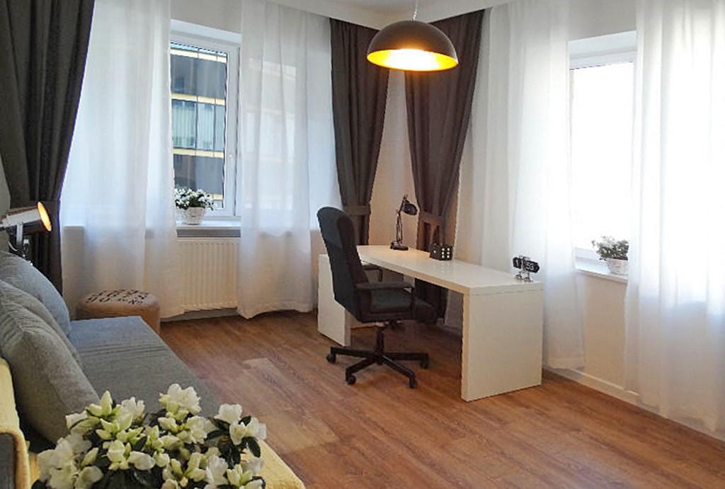 na zdjęciu salon w luksusowym apartamencie do sprzedaży w Warszawie
