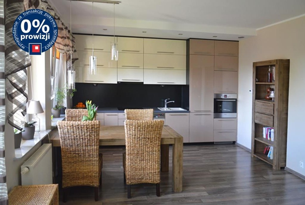 na zdjęciu ekskluzywnie wyposażona kuchnia w apartamencie do sprzedaży w Szczecinie