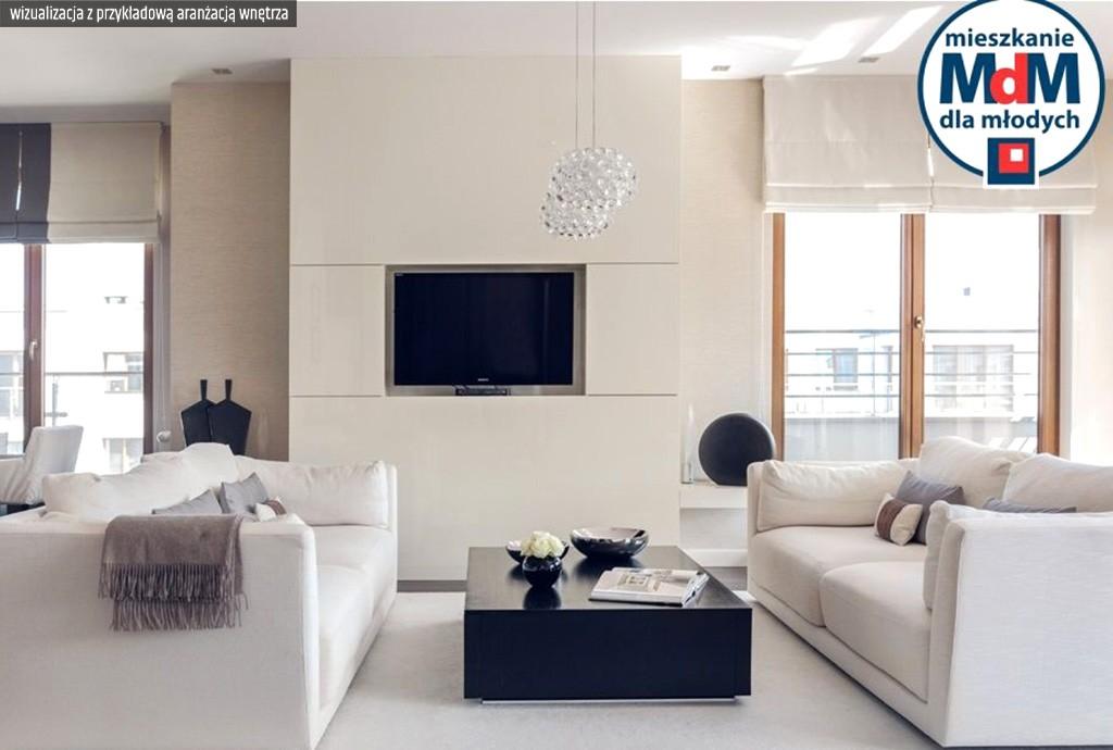 zdjęcie przedstawia luksusowy salon w apartamencie do sprzedaży Legnicy