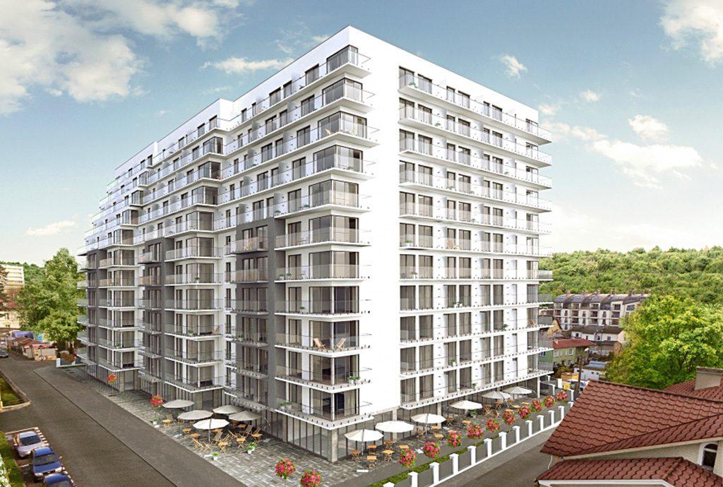 ekskluzywny apartamentowiec nad morzem, w którym znajduje się oferowany na sprzedaż luksusowy apartament