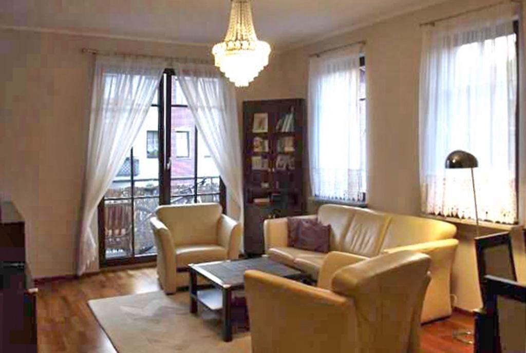 stylowy salon w ekskluzywnym apartamencie do sprzedaży w Szczecinie