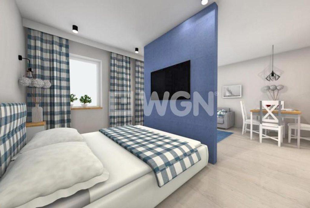nowoczesna sypialnia i aneks kuchenny w ekskluzywnym apartamencie do sprzedaży nad morzem