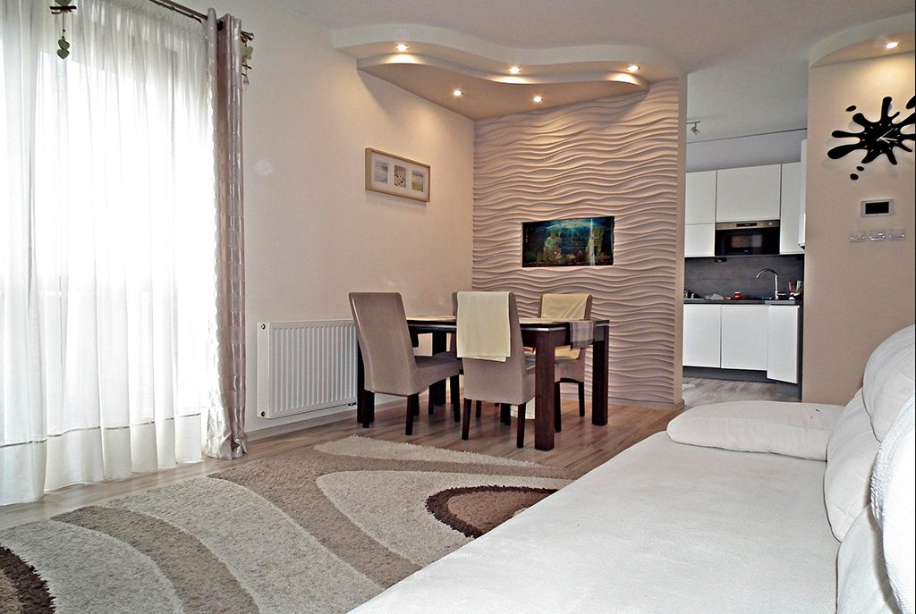 umeblowany w nowoczesnym designie salon w ekskluzywnym apartamencie do sprzedaży w Legnicy