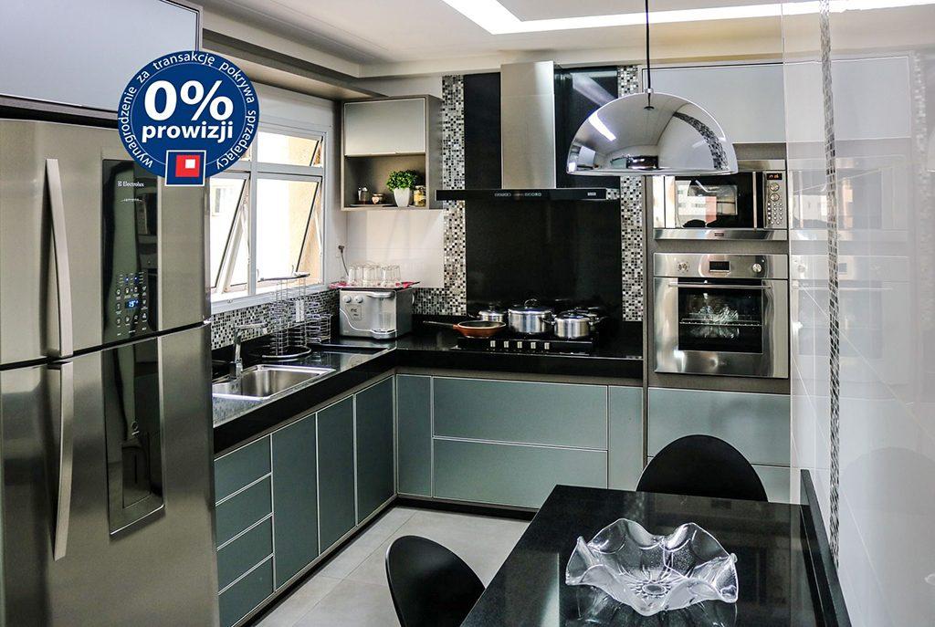 nowocześnie umeblowana kuchnia w luksusowym apartamencie do sprzedaży w Krakowie