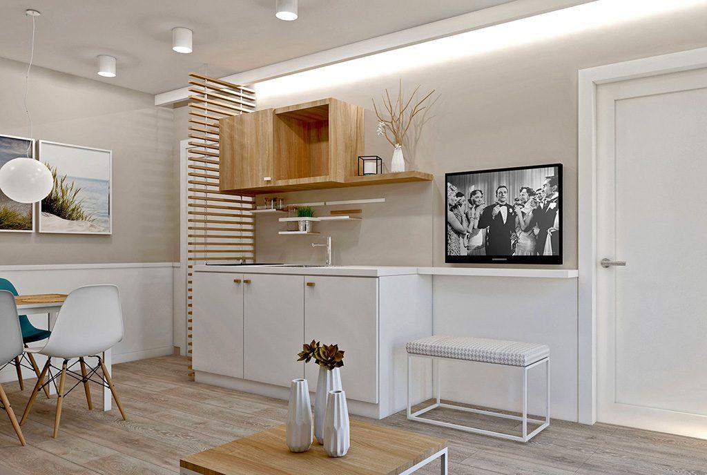 widok z salonu na aneks kuchenny w ekskluzywnym apartamencie do sprzedaży nad morzem