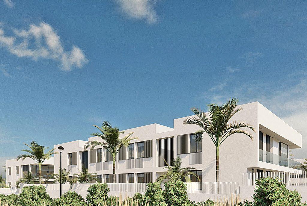 widok od strony ogrodu na luksusowy apartamentowiec, w którym znajduje się oferowany na sprzedaż ekskluzywny apartament Hiszpania (Mar de Cristal)