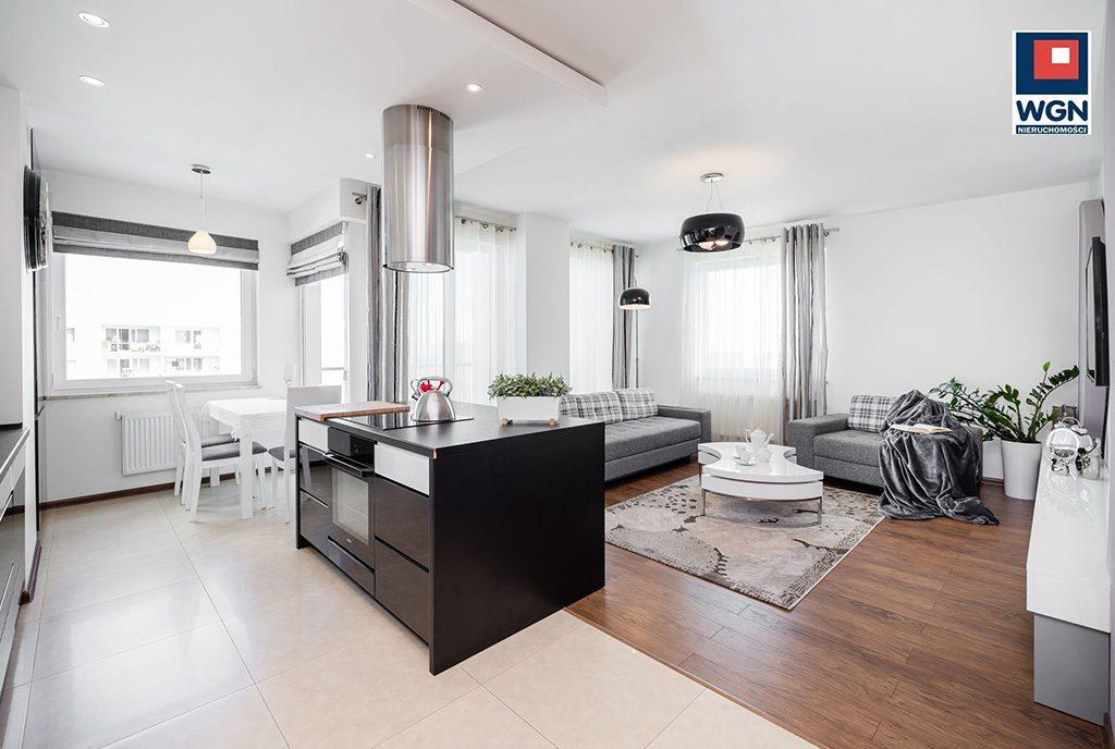 zdjęcie prezentuje komfortową jadalnię i kuchnię w ekskluzywnym apartamencie do sprzedaży Gdańsk
