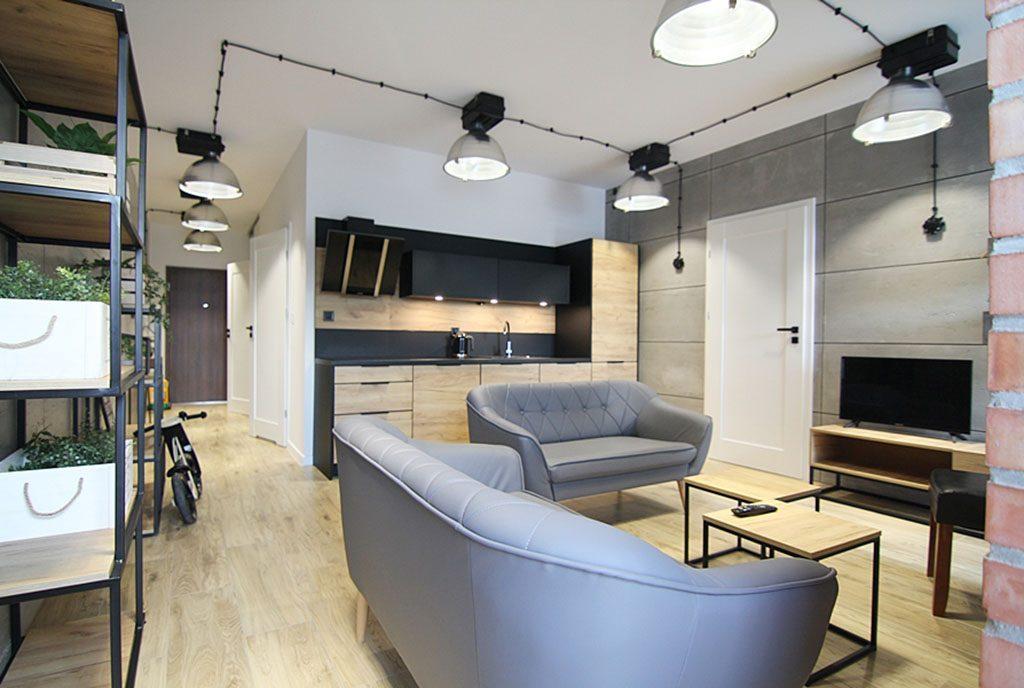 zaaranżowane w modnym trendzie wnętrze salonu w ekskluzywnym apartamencie do wynajęcia Wieluń