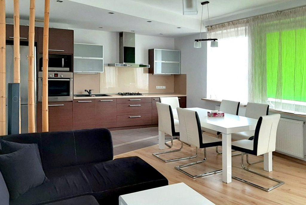 widok od strony salonu na luksusowe wnętrze ekskluzywnego apartamentu do wynajęcia Piotrków Trybunalski