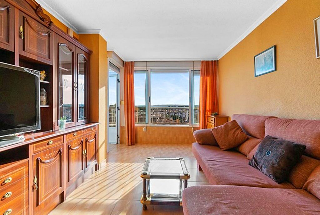 prestiżowy pokój dzienny w ekskluzywnym apartamencie na sprzedaż Hiszpania (Costa Blanca, Orihuela Costa, Punta Prima)