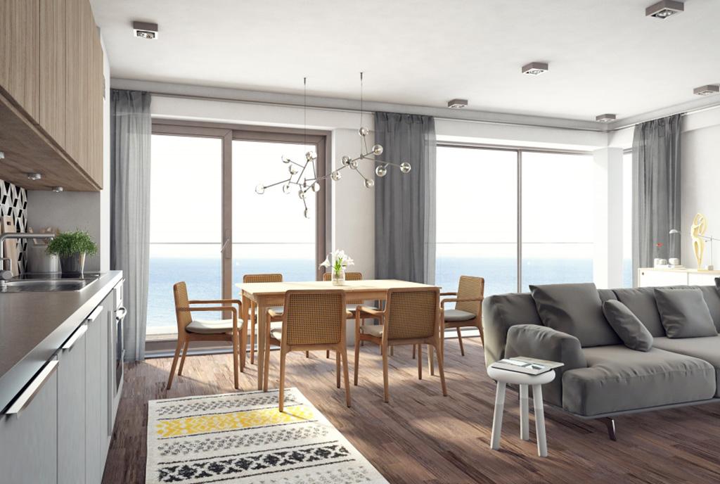 okazały pokój dzienny w ekskluzywnym apartamencie na sprzedaż nad morzem