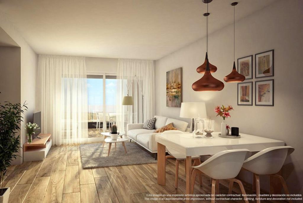 na pierwszym planie jadalnia i luksusowe wnętrze ekskluzywnego apartamentu na sprzedaż Hiszpania