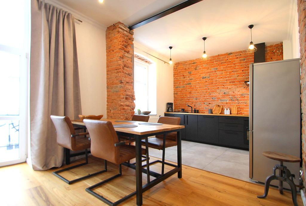 zaprojektowane w stylu loftu wnętrze ekskluzywnego apartamentu do wynajęcia Sieradz