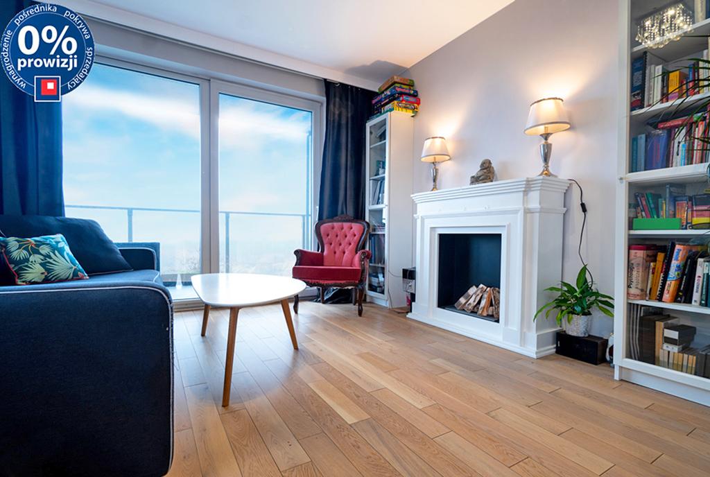 stylowy pokój dzienny z kominkiem w ekskluzywnym apartamencie do sprzedaży Katowice