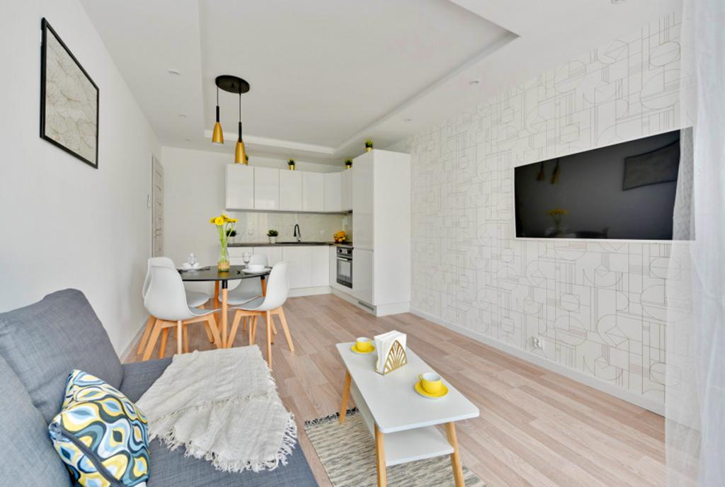 współczesny design salonu w luksusowym apartamencie do sprzedaży Gdańsk
