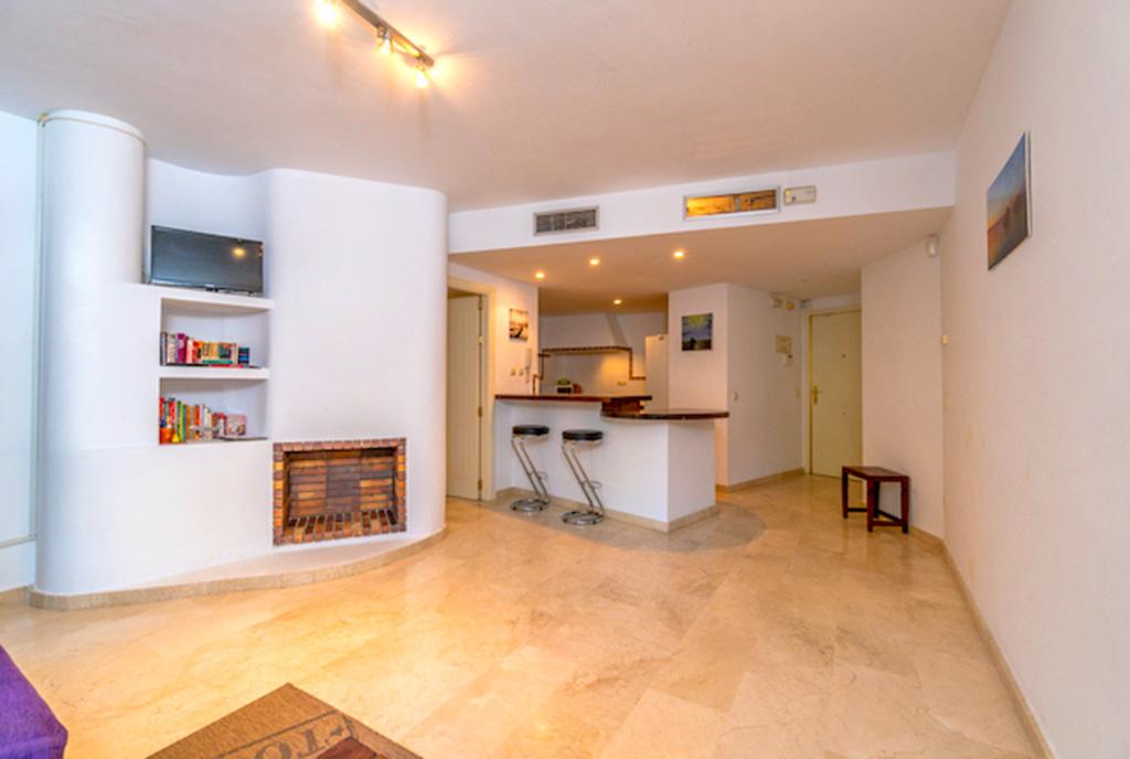 pokój dzienny i kuchnia w ekskluzywnym apartamencie do sprzedaży Hiszpania (Punta Prima)
