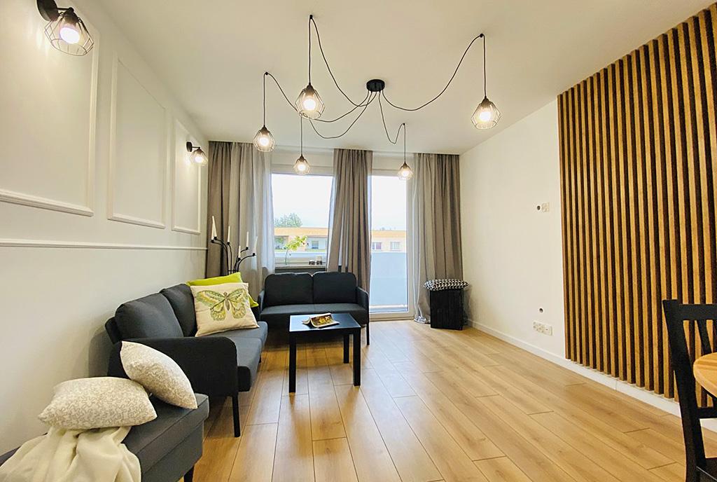 stylowo wykończony pokój dzienny w ekskluzywnym apartamencie do sprzedaży Katowice (okolice)